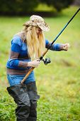 picture of fisherwomen  - beautiful blond girl fishing in pond at autumn - JPG