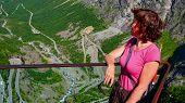 Tourist Woman On Trollstigen Viewpoint. Trolls Path Or Trollstigveien Mountain Road In Norway. Natio poster