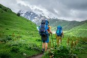 Trekking In Mountains. Mountain Trail With Tourists. Svaneti Mountains Trekking. Active Leisure In M poster