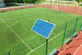 Solar Panel On The Rack. The Panel Is Located On The Sports Field. Stadium Lighting. poster