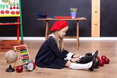 Back To School! A Girl Sits On The Floor At School And Holds A Retro Typewriter. School Education. L poster