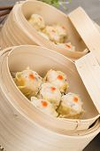 pic of siomai  - Siu Mai - Chinese steamed pork dumplings in bamboo steamers. Dim Sum