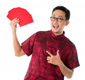 Asian Chinese man showing many red packets / ang pow , isolated on white background