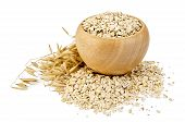 foto of oats  - Oat flakes in a wooden bowl - JPG