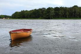 stock photo of sloop  - Fishing boat on the lake - JPG