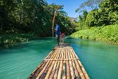 image of jamaican  - River Boat and Captain on Martha Brae River in Jamaica - JPG