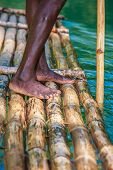 image of martha  - Feet of River Boat and Captain on Martha Brae River in Jamaica - JPG