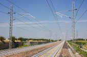image of railroad yard  - Railroad tracks that is vanishing into the distance - JPG
