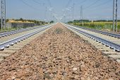 stock photo of railroad yard  - A Railroad track vanishing into the distance - JPG