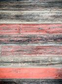 image of red siding  - Red weathered boards on wood siding texture - JPG