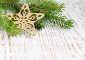 picture of winterberry  - Christmas border with pine tree on a wooden background - JPG