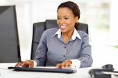 stock photo of black american  - beautiful young african american businesswoman working on computer - JPG