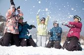 Group of People Playing in the Snow in Ski Resort