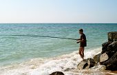 stock photo of azov  - The young men fishing in sea of Azov - JPG