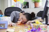 stock photo of office party  - Female Asleep After Party at Office - JPG