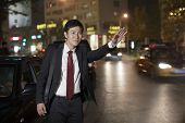 picture of cabs  - Businessman Hailing Taxi Cab - JPG