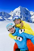 Skiing, winter sports -  young skiers having fun on ski