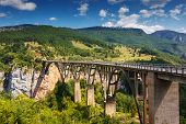Old big bridge in Durdevica and fantastic view Tara river gorge - is the biggest one canyon in Europ poster