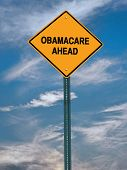 picture of lobbyist  - obamacare ahead conceptual directional post over blue sky - JPG