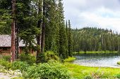 stock photo of log cabin  - Log cabin at Bridal Lake in Kootenay Rockies - JPG