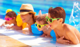 stock photo of three sisters  - Happy family in the pool - JPG