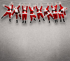 image of sling bag  - Christmas Santa hanging on rope - JPG