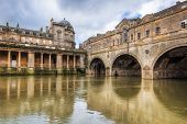 foto of avon  - Completed in 1774 designed by Robert Adam in a Palladian style Pulteney Bridge crosses the River Avon in Bath England UK Europe - JPG