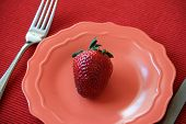 Plump,juicy strawberry on plate
