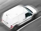 foto of caddy  - white commercial caddy car in blurry speed - JPG