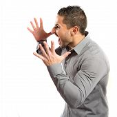 Young Man Screaming Over Isolated White Background