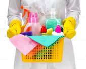 Cleaner maid woman with plastic basket and cleaning supplies on white background