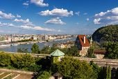 foto of puffy  - Panorama of Budapest with the Elizabeth Bridge Danube and the Gellert hill in a clear sunny weather with puffy clouds Hungary - JPG