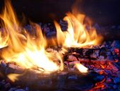 stock photo of hades  - Flames in a fire pit with glowing embers - JPG