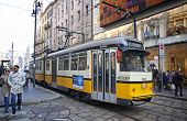 Traditional Yellow Tram On The Street Of Milan