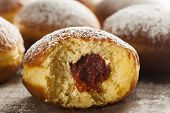 pic of lent  - Homemade Raspberry Polish Paczki Donut with Powdered Sugar