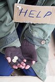 picture of beggar  - Beggar hands with coins asking for a help - JPG
