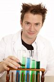 picture of mad scientist  - A mad scientist is ready to pick up a test tube - JPG
