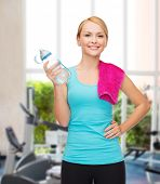 sport, excercise and healthcare - sporty woman with pink towel and water bottle