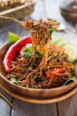 Indonesian and Malaysian cuisine, spicy fried noodles, mi goreng or mee goreng mamak with wooden din