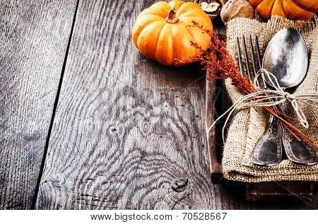 Seasonal Table Setting With Small Pumpkins poster
