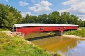 stock photo of covered bridge  - Built in 1876 West Union Covered Bridge crosses Sugar Creek and is the longest of thirty - JPG
