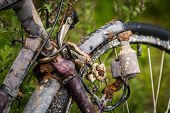 pic of dynamo  - An old bicycle that has long been in the water of a river - JPG