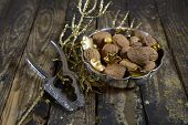foto of nutcracker  - Silver bowl mit walnuts and nutcracker for christmas.
