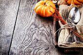 stock photo of plating  - Seasonal table setting with small pumpkins and autumn decoration