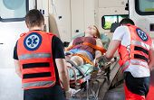 image of ambulance  - Woman after accident in an ambulance horizontal - JPG