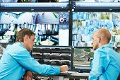 picture of cctv  - two security guards watching video monitoring surveillance security system - JPG