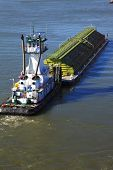 picture of workhorses  - A powerful push boat turning the barge in positions for docking - JPG