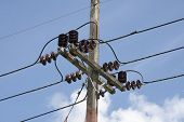 picture of utility pole  - Electricity pole and wires sgainst a blue sky - JPG
