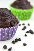 image of chocolate muffin  - Close up of chocolate muffins on a white table with a lot of chocolate - JPG