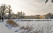 stock photo of winter palace  - Aleksandrovsky palace next to frozen pond in winter Pushkin Russia - JPG